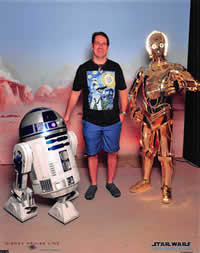 Tim meets his mystery friends.. R2D2 and C3PO.